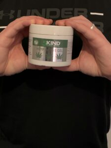 picture of me holding my tub of 5kind hemp cream
